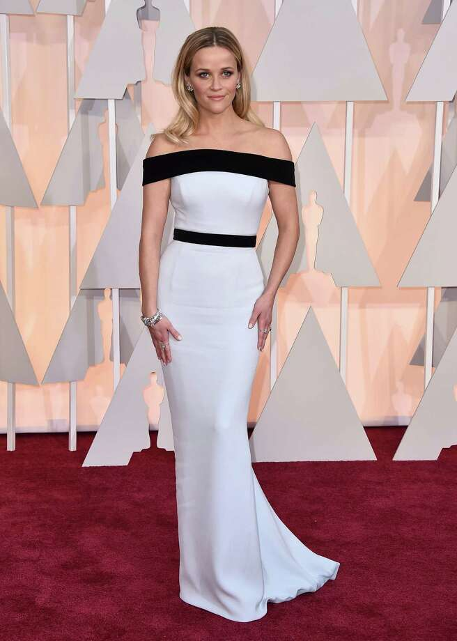 Worst: Reese Witherspoon. This night has too much white fashion, too much black fashion and too much nothing hair. You have it all.  Photo: Jordan Strauss, Associated Press / Invision