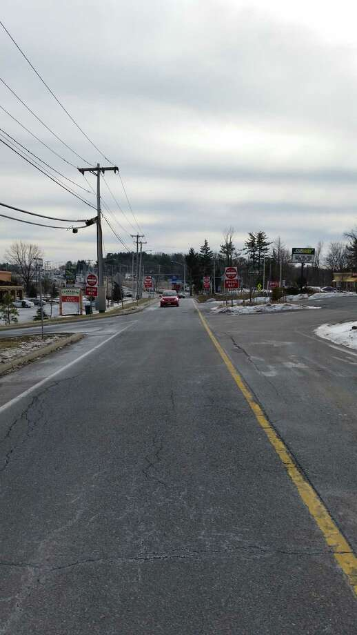 Signs on Fort Ferry Road warn drivers not to continue onto a one-way street. (Photo by Colonie Department of Public Works)