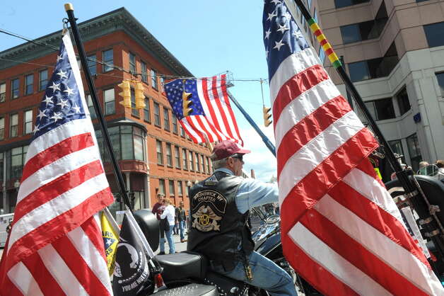 Ray Sestak of Glenmont, a Patriot Guards member, sits on his motorcycle during a street festival on South Pearl Street in front of the Times Union Center in Albany before a Charlie Daniels concert that benefited a Soldier On veterans housing project on May 31. (Michael P. Farrell / Times Union Archive)