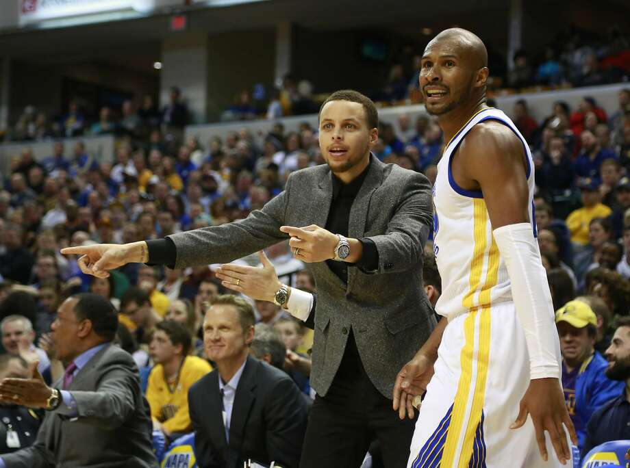 Golden State Warriors guards Stephen Curry, left, and Leandro Barbosa question a call from the bench in the second half of an NBA basketball game against the Indiana Pacers, Sunday, Feb. 22, 2015, in Indianapolis. Indiana won 104-98. (AP Photo/R Brent Smith) Photo: R Brent Smith, Associated Press