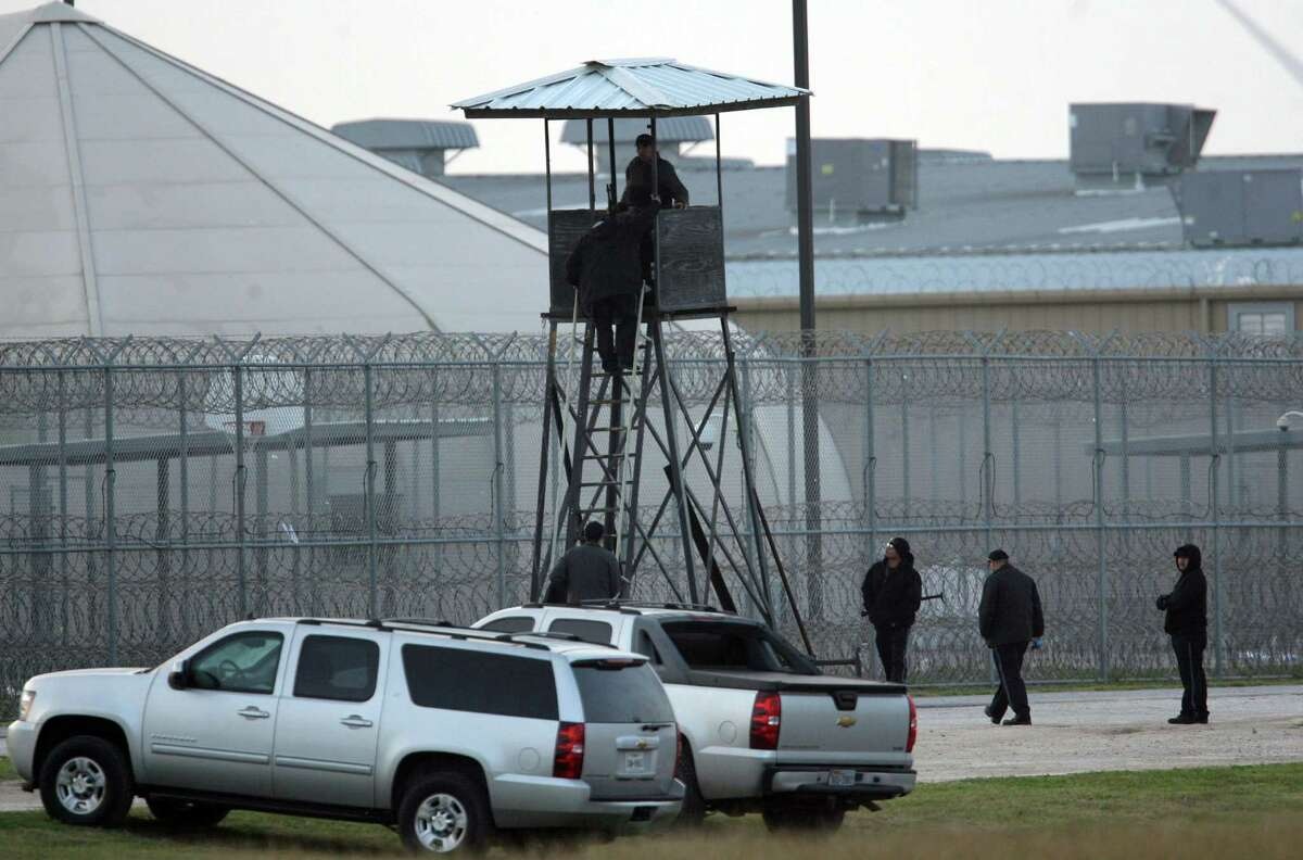 Correctional guards at the Willacy County Correctional Center in Raymondville, Texas stand watch at a tower early Saturday Feb.21, 2015. Photo by Delcia Lopez