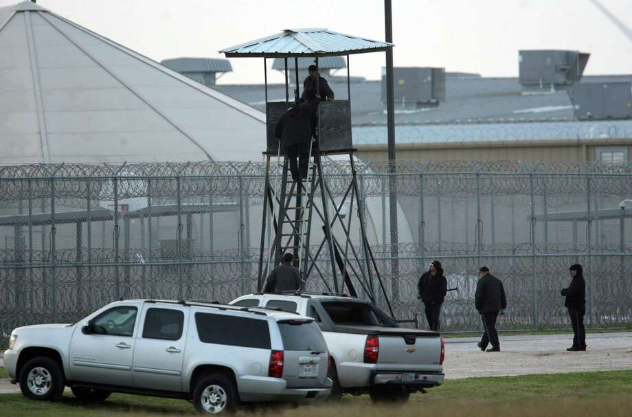 Correctional guards at the Willacy County Correctional Center in Raymondville, Texas stand watch at a tower early  Saturday Feb.21, 2015. Photo by Delcia Lopez Photo: Delcia Lopez, MBR / AP / Delcia Lopez photography