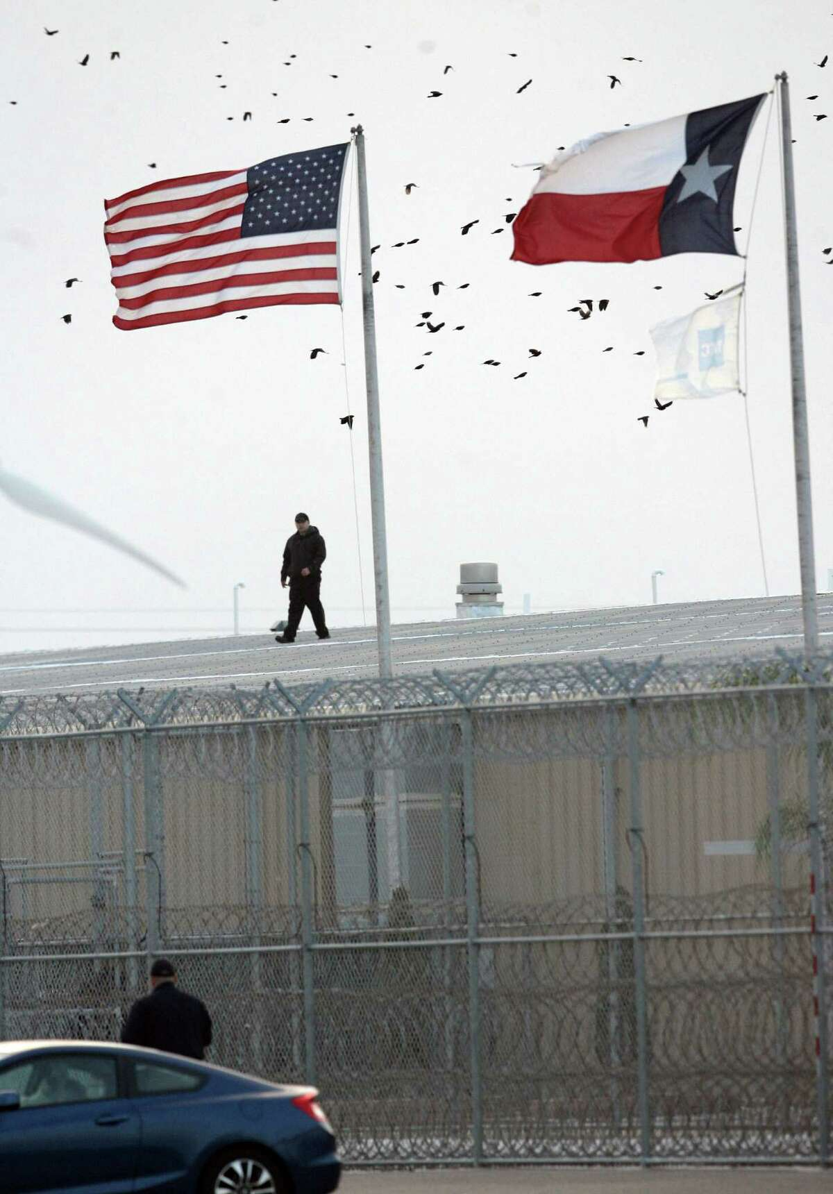 A guard walks on a roof at at the Willacy County Correctional Center in Raymondville. The facility held as many as 2,800 immigrants charged with low-level crimes.