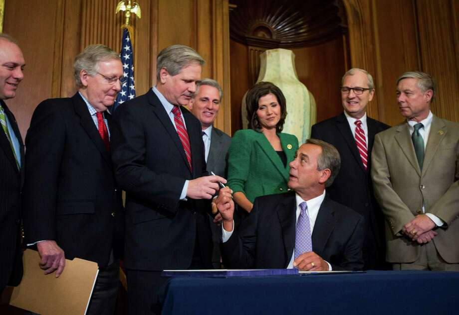 House Speaker John Boehner, R-Ohio, hands the pen to Sen. John Hoeven, R-N.D., after signing the bill authorizing the Keystone XL pipeline in a ceremony on Capitol Hill in Washington Photo: JABIN BOTSFORD, STF / NYTNS