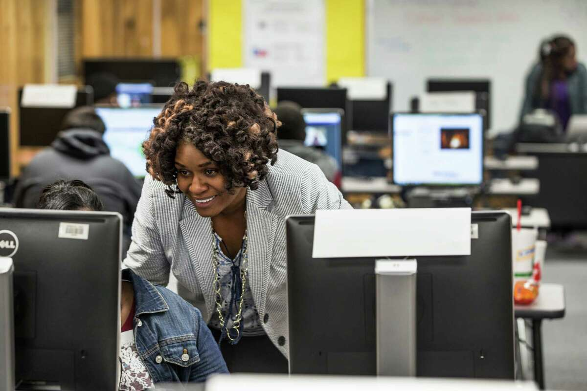 Marsha Wilson, virtual school counselor, works with a student during an evening class at Dekaney High School on Feb. 19. Spring ISD is holding evening classes for students, many of whom are now seeking to recover credits they are missing because of widespread scheduling and transcript errors revealed recently.