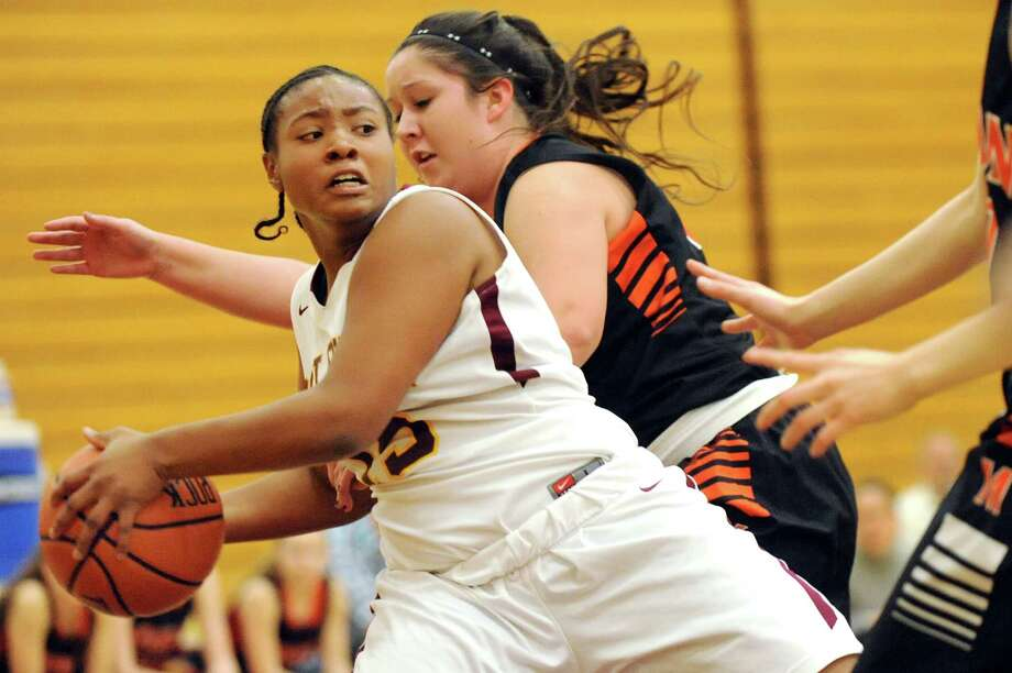 Colonie's Myaisha Kelly, left, keeps the ball in bounds as Mohonasen's Molly Sloan defends during their basketball game on Friday, Jan. 9, 2015, at Colonie High in Colonie, N.Y. (Cindy Schultz / Times Union) Photo: Cindy Schultz / 00030149A