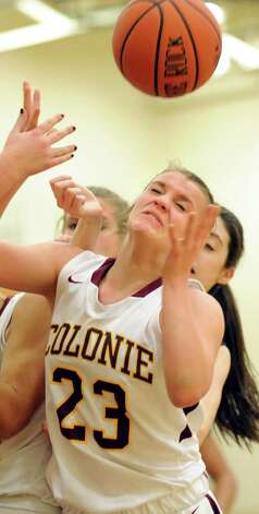 Colonie's Erin Fouracre fights for a rebound during their basketball game against Mohonasen on Friday, Jan. 9, 2015, at Colonie High in Colonie, N.Y. (Cindy Schultz / Times Union) Photo: Cindy Schultz / 00030149A
