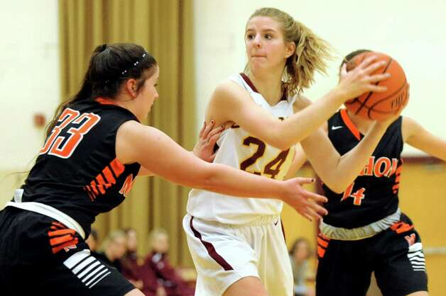 Colonie's Alivia Paeglow, center, keeps the ball away from Mohonasen's Molly Sloan during their basketball game on Friday, Jan. 9, 2015, at Colonie High in Colonie, N.Y. (Cindy Schultz / Times Union) Photo: Cindy Schultz / 00030149A