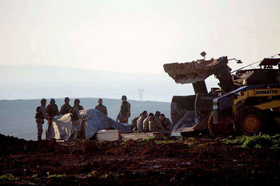 A Turkish troops are seen as some of them work to build a new Ottoman tomb in Esme village in Aleppo province, Syria, Sunday, Feb. 22, 2015. Turkey launched an overnight military operation into neighboring Syria to evacuate troops guarding an Ottoman tomb and to move the crypt to a new location, Turkish Prime Minister Ahmet Davutoglu said Sunday. Davutoglu said they plan to build a new Ottoman tomb in Esme village, close to Turkey-Syria border. (AP Photo/Mursel Coban, Depo Photos) Photo: Mursel Coban, STR / Associated Press / Depo Photos