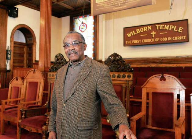Pastor Solomon Dees in the sanctuary of Wilborn Temple Friday Feb. 20, 2015 in Albany, NY.  (John Carl D'Annibale / Times Union) Photo: John Carl D'Annibale / 00030700A