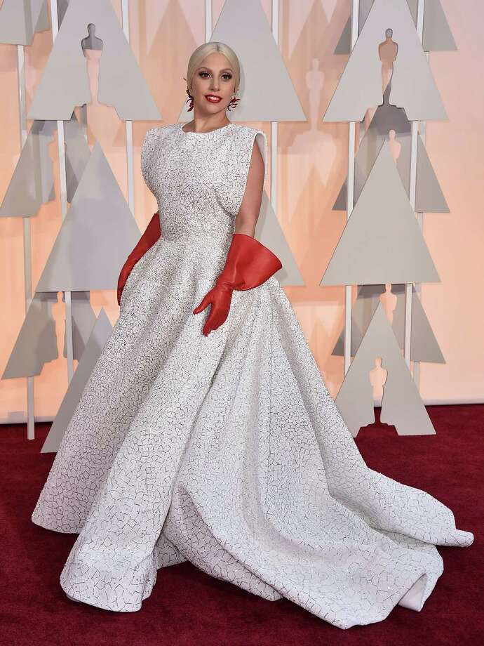 Lady Gaga arrives at the Oscars on Sunday, Feb. 22, 2015, at the Dolby Theatre in Los Angeles. (Photo by Jordan Strauss/Invision/AP) Photo: Jordan Strauss / Associated Press / Invision