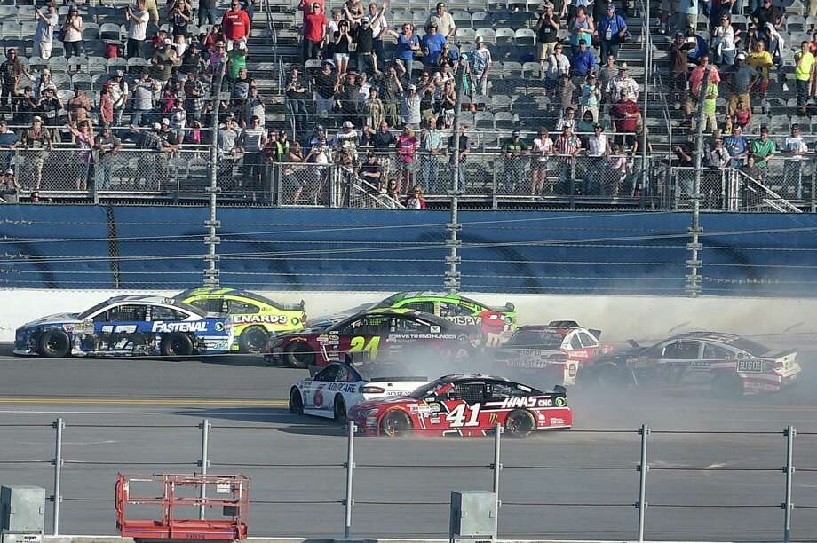 Ricky Stenhouse Jr. (17), Paul Menard (27), Jeff Gordon (24), Matt Crafton (18), Trevor Bayne (6), Regan Smith (41), AJ Allmendinger (47) and Reed Sorenson (44) collide in the back stretch on the final lap of the Daytona 500 NASCAR Sprint Cup series auto race at Daytona International Speedway, Sunday, Feb. 22, 2015, in Daytona Beach, Fla.(AP Photo/Phelan M. Ebenhack) ORG XMIT: DBR612 Photo: Phelan M. Ebenhack / FR121174 AP