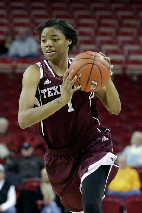 Texas A&M's Courtney Williams takes the ball down court in first half of an NCAA college basketball game against Arkansas in Fayetteville, Ark., Sunday, Jan. 4, 2015. Williams scored 18 points in A&M's 52-50 victory over Arkansas. (AP Photo/Danny Johnston) Photo: Danny Johnston, STF / AP