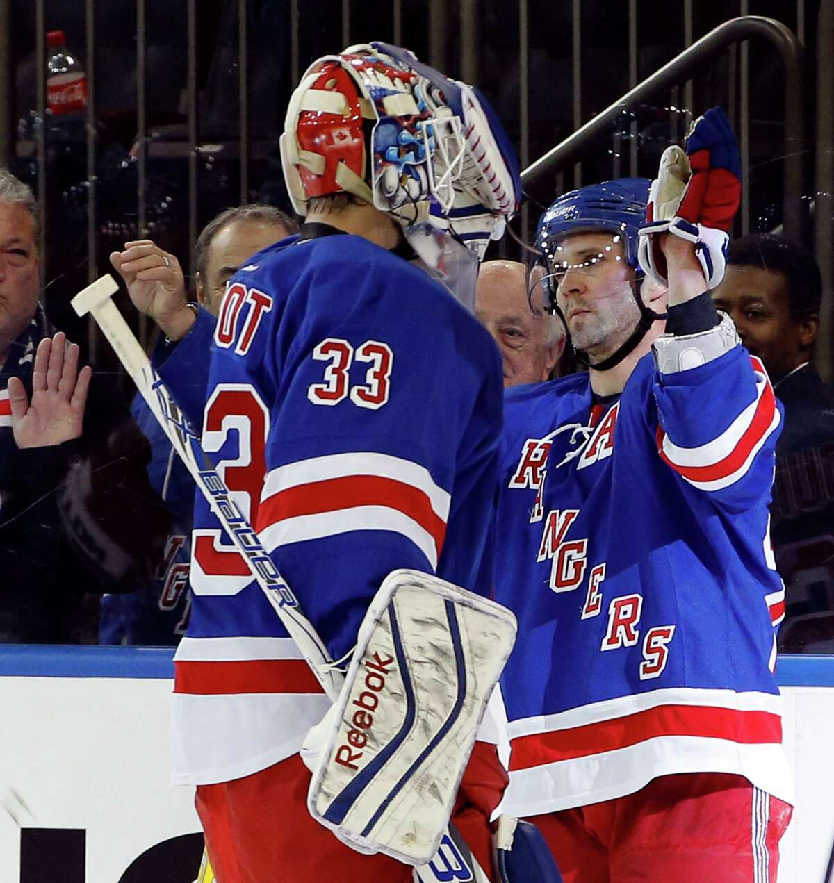 New York Rangers right wing Martin St. Louis (26) celebrates with New York Rangers goalie Cam Talbot (33) after an NHL hockey game against the Columbus Blue Jackets at Madison Square Garden in New York, Sunday, Feb. 22, 2015. The Rangers defeated the Blue Jackets 4-3 in a shootout on Rick Nash's goal. (AP Photo/Kathy Willens) ORG XMIT: MSG111