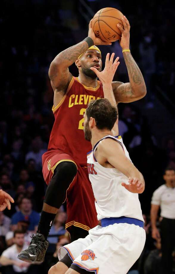 Cleveland Cavaliers' LeBron James, top, shoots over New York Knicks' Jose Calderon during the first half of an NBA basketball game, Sunday, Feb. 22, 2015, in New York. (AP Photo/Seth Wenig) ORG XMIT: NYSW116 Photo: Seth Wenig / AP