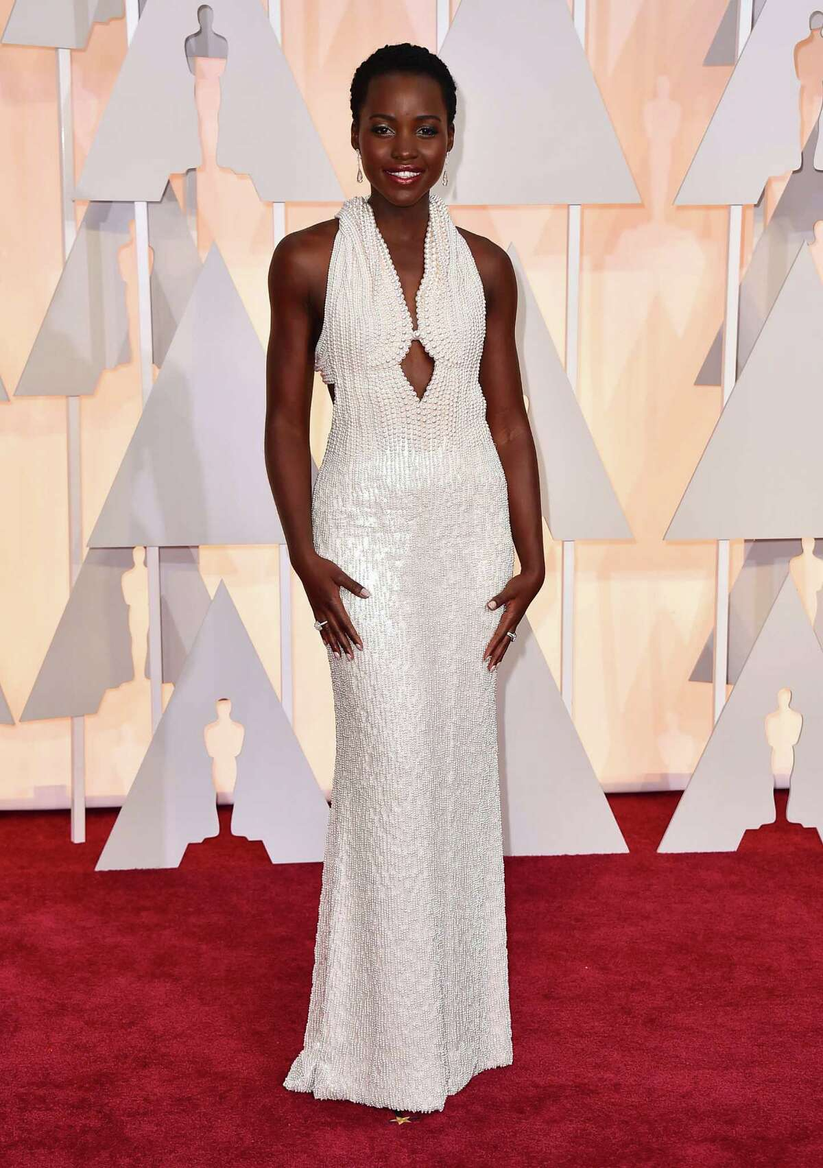 WHITE: Lupita Nyong'o, a presenter at this year's Oscars and a 2014 Best Supporting Actress winner, wore a Calvin Klein Collection dress that had 6,000 pearls sewn on.
