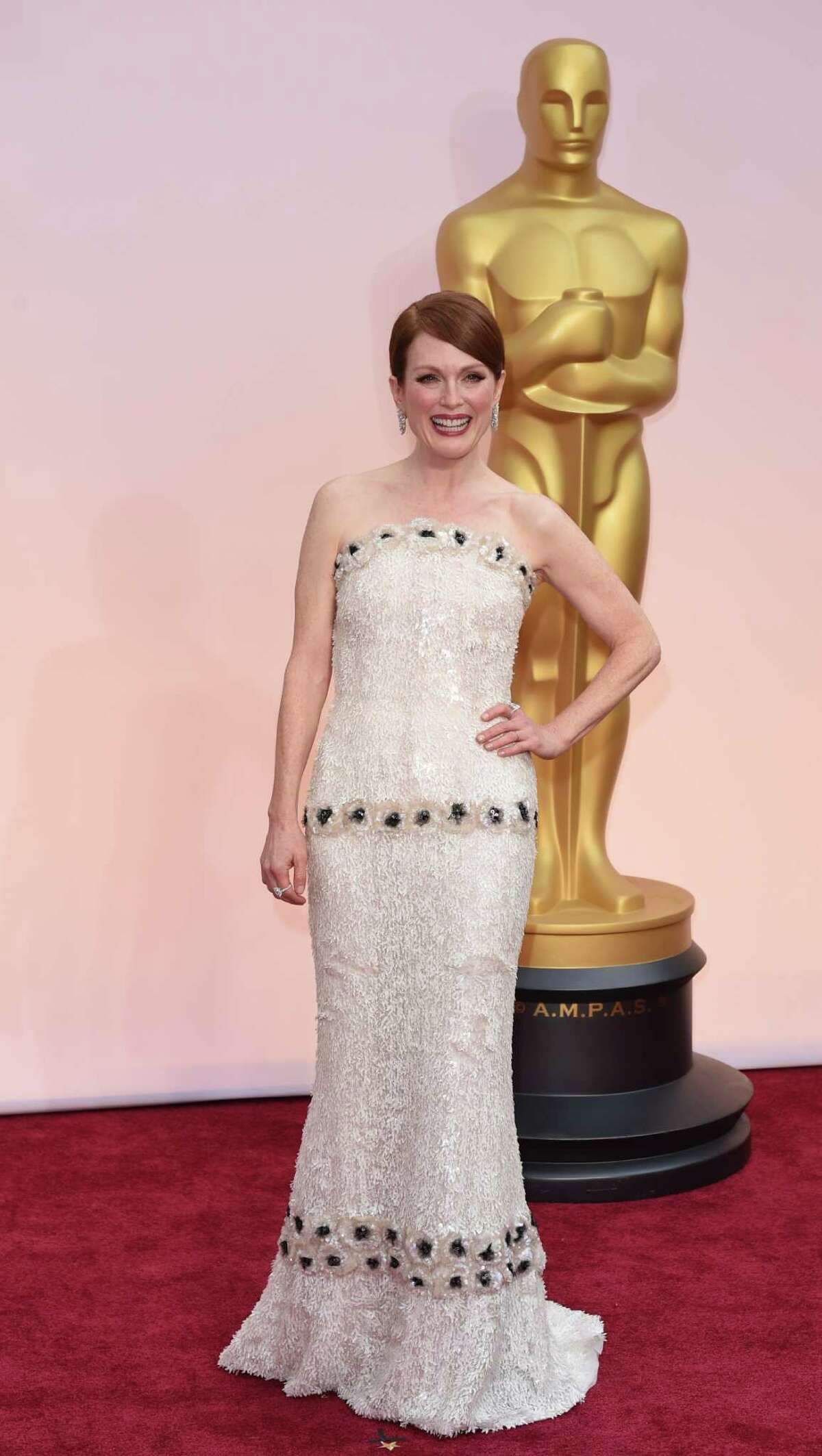 WHITE: Julianne Moore wore a sparkling Chanel Haute Couture dress.