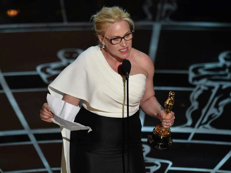 """Patricia Arquette accepts the award for best actress in a supporting role for """"Boyhood"""" at the Oscars on Sunday, Feb. 22, 2015, at the Dolby Theatre in Los Angeles. (Photo by John Shearer/Invision/AP) ORG XMIT: CACJ365 Photo: John Shearer / Invision"""