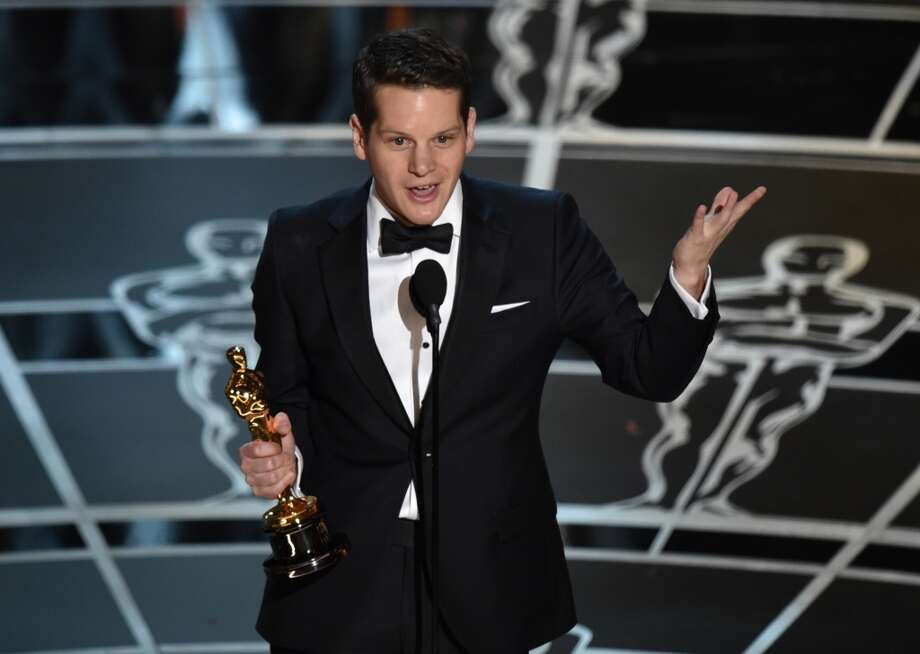 "Graham Moore accepts the award for the best adapted screenplay for ""The Imitation Game"" at the Oscars on Sunday, Feb. 22, 2015, at the Dolby Theatre in Los Angeles. (Photo by John Shearer/Invision/AP) Photo: John Shearer, Associated Press"
