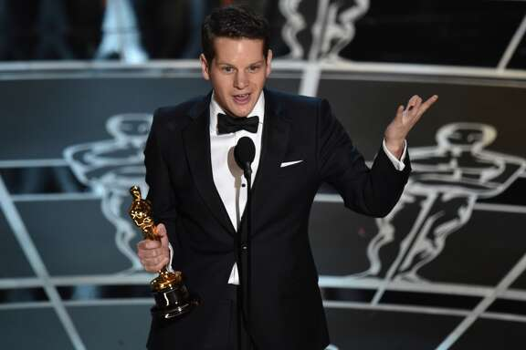 "Graham Moore accepts the award for the best adapted screenplay for ""The Imitation Game"" at the Oscars on Sunday, Feb. 22, 2015, at the Dolby Theatre in Los Angeles. (Photo by John Shearer/Invision/AP)"