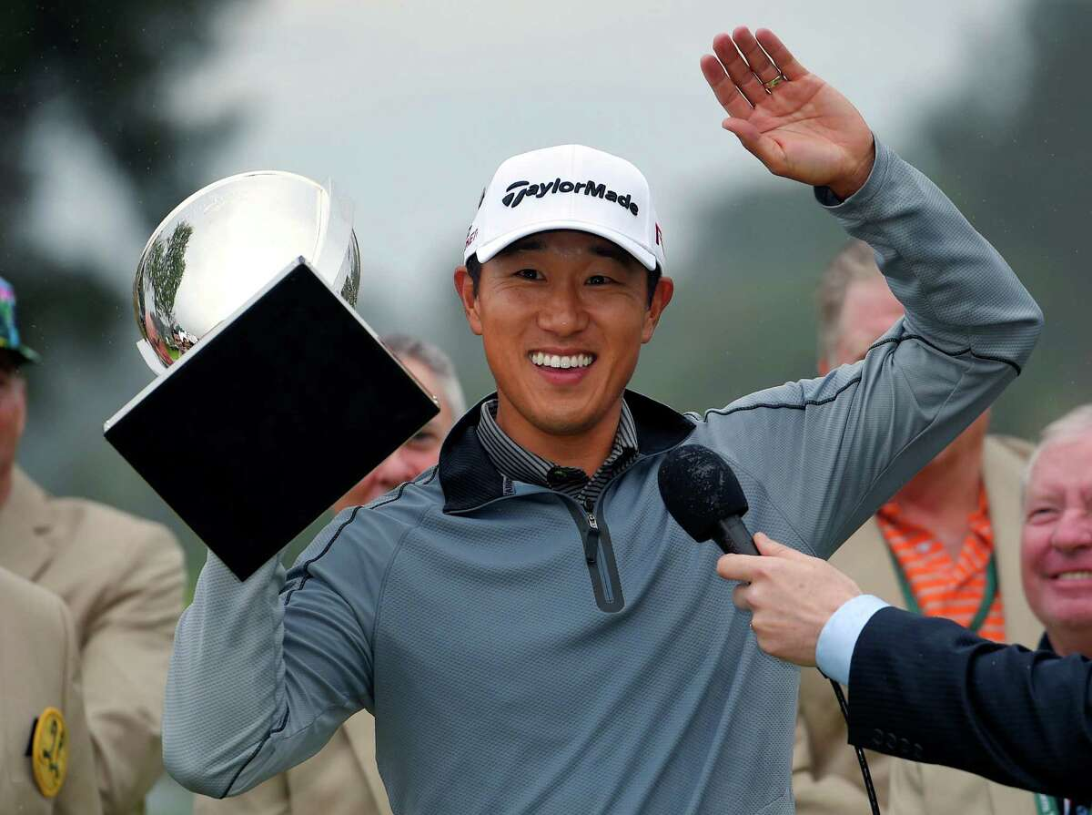 James Hahn holds up his trophy after winning the Northern Trust Open golf tournament on the third hole of a playoff at Riviera Country Club, Sunday, Feb. 22, 2015, in Los Angeles. (AP Photo/Mark J. Terrill)