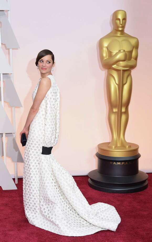 Nominee for Best Actress Marion Cotillard  arrives on the red carpet for the 87th Oscars February 22, 2015 in Hollywood, California. AFP PHOTO / MARK RALSTONMARK RALSTON/AFP/Getty Images Photo: MARK RALSTON / AFP / Getty Images / AFP