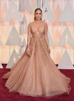Jennifer Lopez wears an Elie Saab tulle-layered confection that was more prom night than a date with Oscar. Photo: Jordan Strauss, Jordan Strauss/Invision/AP / Invision