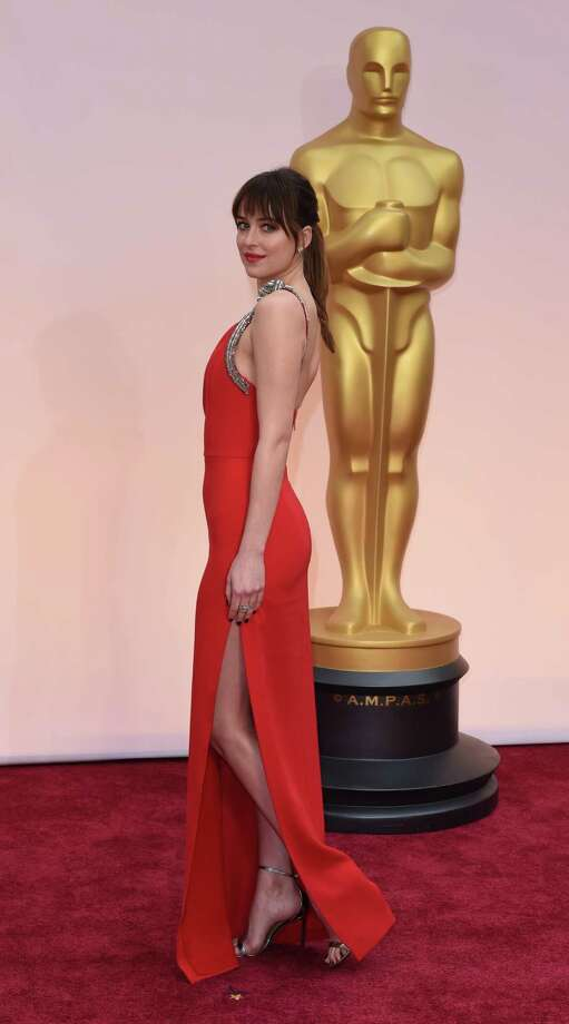 Dakota Johnson is anything but gray is this provocative gown. Photo: MARK RALSTON, AFP / Getty Images / AFP