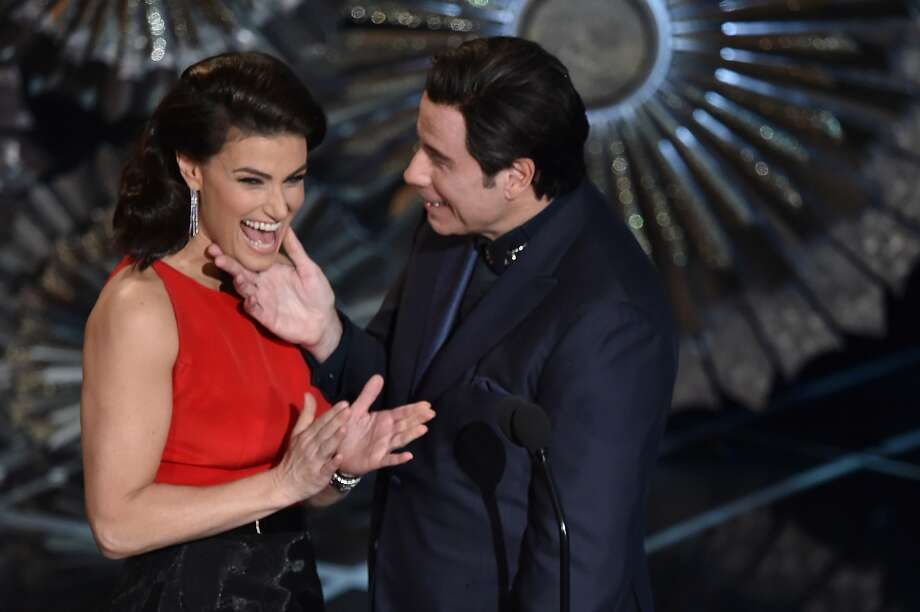 HOLLYWOOD, CA - FEBRUARY 22:  Actress Idina Menzel and actor John Travolta speak onstage during the 87th Annual Academy Awards at Dolby Theatre on February 22, 2015 in Hollywood, California.  (Photo by Kevin Winter/Getty Images) Photo: Kevin Winter, Getty Images