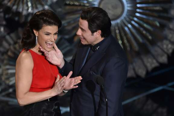 HOLLYWOOD, CA - FEBRUARY 22:  Actress Idina Menzel and actor John Travolta speak onstage during the 87th Annual Academy Awards at Dolby Theatre on February 22, 2015 in Hollywood, California.  (Photo by Kevin Winter/Getty Images)