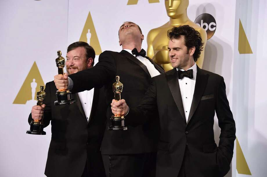 Thomas Curley, left, Ben Wilkins and Craig Mann pose in the press room with the award for best sound mixing for iWhiplashi at the Oscars on Sunday, Feb. 22, 2015, at the Dolby Theatre in Los Angeles. (Photo by Jordan Strauss/Invision/AP)  ORG XMIT: MER2015022300262624 Photo: Jordan Strauss / Invision