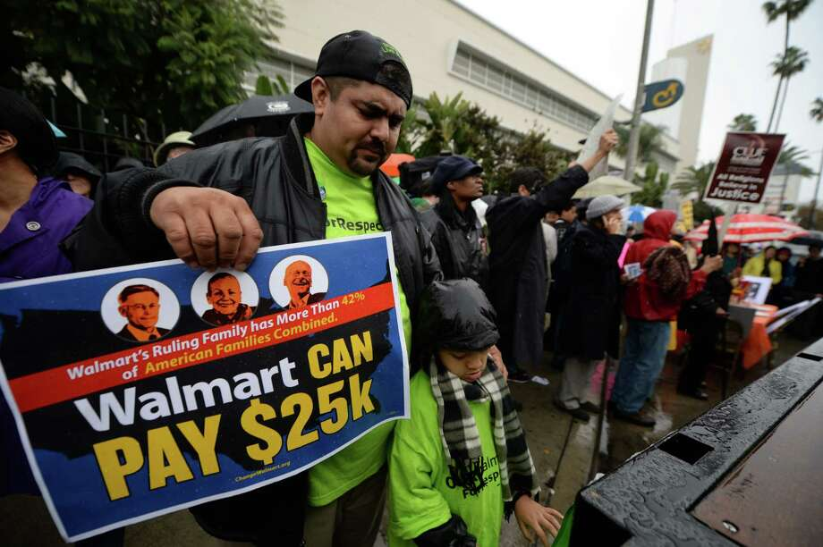 Walmart wages: By the numbersWalmart has announced that in April 2015, it will begin paying its minimum wage workers $9 per hour – $1.75 above the federal minimum wage. In February 2016, Walmart's minimum wage then will increase to $10.Here's what you need to know about Walmart and the minimum wage, by the numbers ... Photo: ROBYN BECK, Dylan Baddour / 2013 AFP
