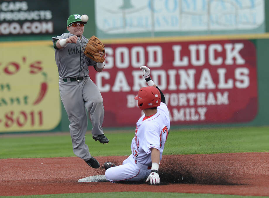 Lamar University's Brandon Provost is out at second as Manhattan College's Jose Carrera looks to complete the double play during the first of Friday's double-header games. The action continues with another double-header match-up Saturday.  Photo taken Friday, February 20, 2015  Kim Brent/The Enterprise Photo: Kim Brent / Beaumont Enterprise