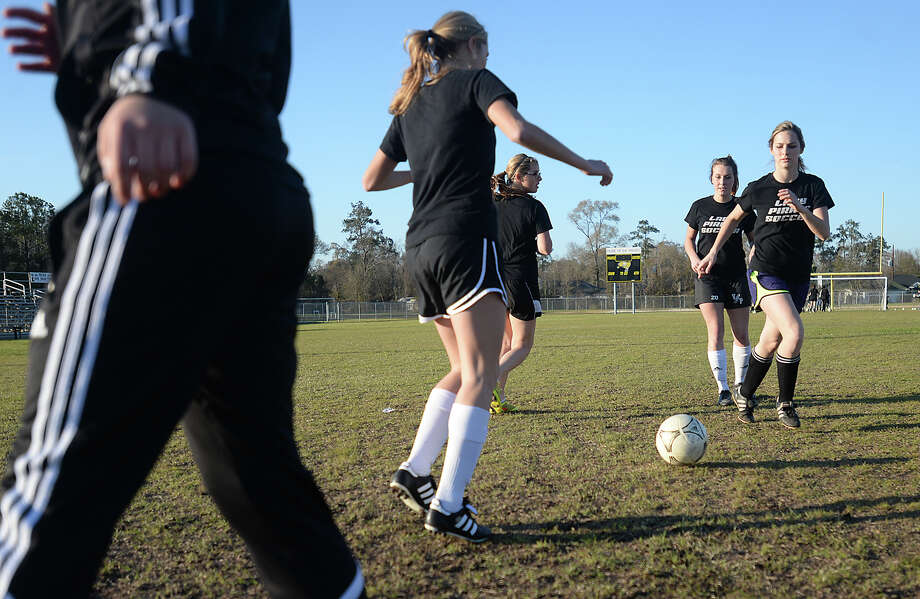 Vidor's varsity girls, including Madison Chilton, practice close passing as they continue preparations for the play-off season after school Thursday.   Photo taken Thursday, February 18, 2015  Kim Brent/The Enterprise Photo: Kim Brent / Beaumont Enterprise