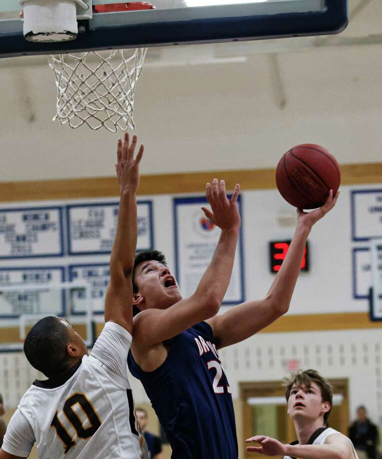 GFA senior Dugald Shannon goes in for a layup during the team's Feb. 18 game against Brunswick. The Dragons lost 74-73. Photo: Contributed Photo / Westport News Contributed