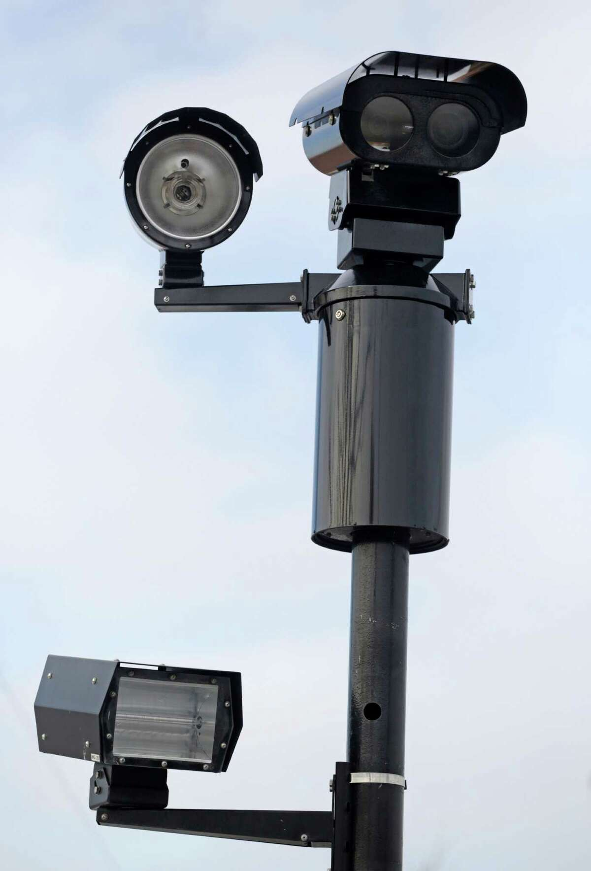 """This photo taken Tuesday, Feb. 10, 2015, shows a red light camera in Chicago. The fight over red-light cameras has landed in the Illinois Legislature, where lawmakers who say the recording devices are """"dishonest"""" and fail to make driving safer are pushing to ban them in communities across the state. (AP Photo/M. Spencer Green)"""