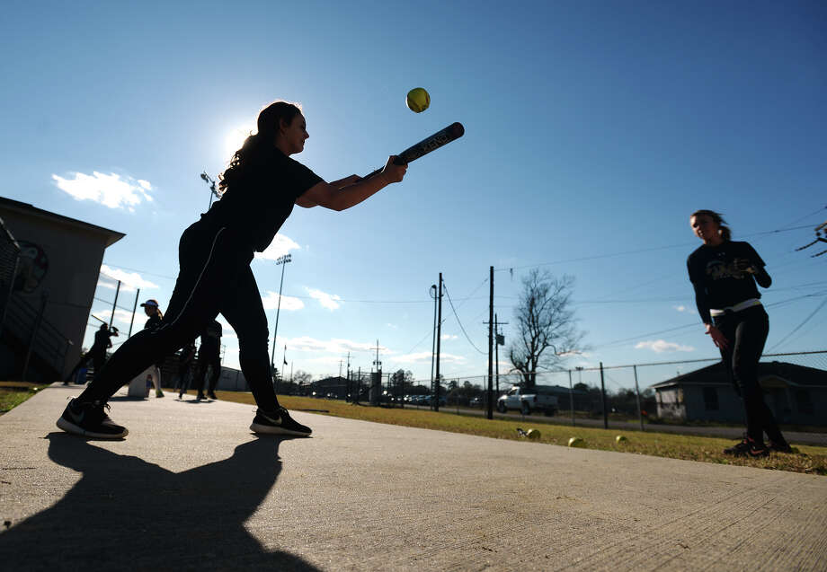 Vidor's Kaleigh Desormeaux, left, leans in for a bunt pitched her way by Baylee Brannon during practice Wednesday. The Vidor Lady Pirates softball team practiced Wednesday afternoon. Photo taken Wednesday 2/18/15 Jake Daniels/The Enterprise Photo: Jake Daniels / ©2014 The Beaumont Enterprise/Jake Daniels