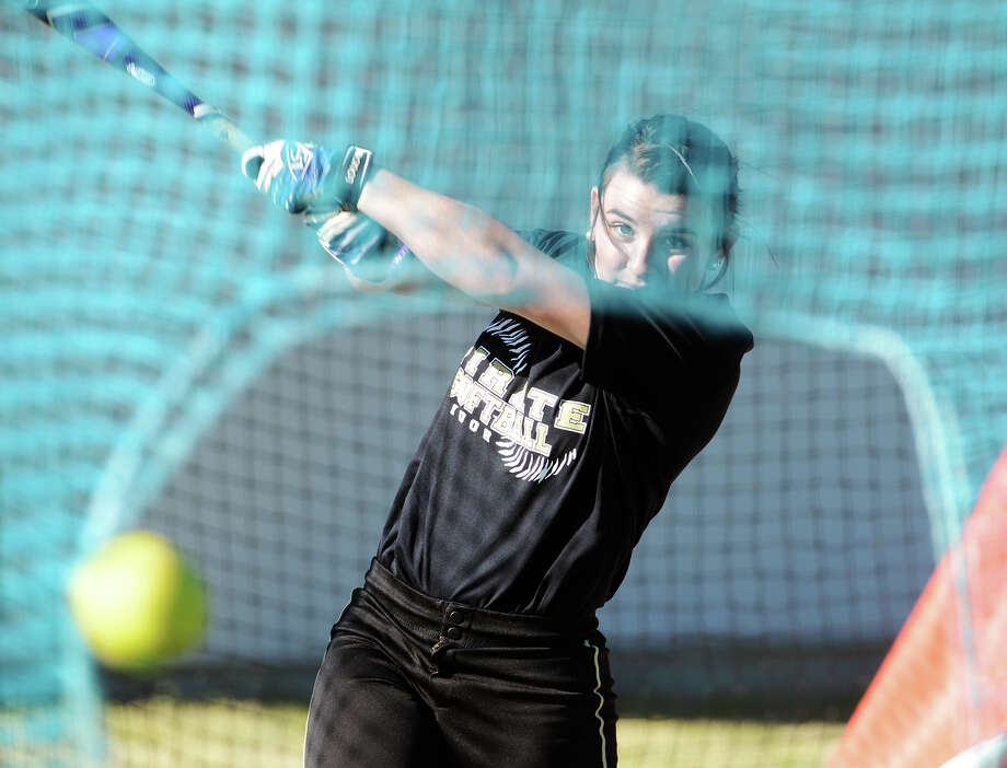 Vidor's Keeli Milligan knocks a softball through a net inside a batting cage Wednesday. The Vidor Lady Pirates softball team practiced Wednesday afternoon.  Photo taken Wednesday 2/18/15  Jake Daniels/The Enterprise Photo: Jake Daniels / ©2014 The Beaumont Enterprise/Jake Daniels
