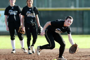 Vidor's Keeli Milligan moves to intercept a ground ball during practice Wednesday afternoon. The Vidor Lady Pirates softball team practiced Wednesday afternoon. Photo taken Wednesday 2/18/15 Jake Daniels/The Enterprise