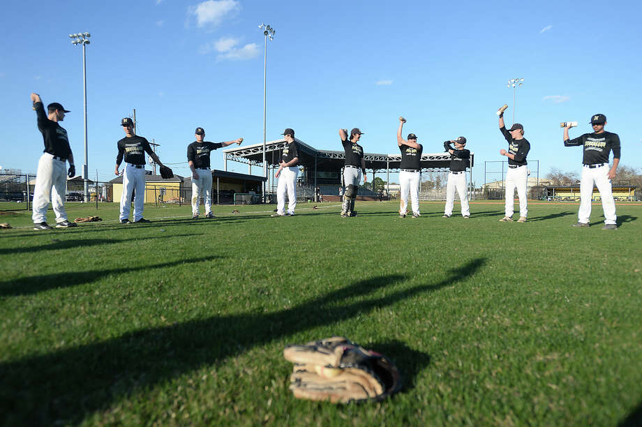 Nederland's baseball team warms up using weighted bottles during practice after school Wednesday as they prepare for the spring season.  Photo taken Wednesday, February 18, 2015  Kim Brent/The Enterprise Photo: Kim Brent / Beaumont Enterprise