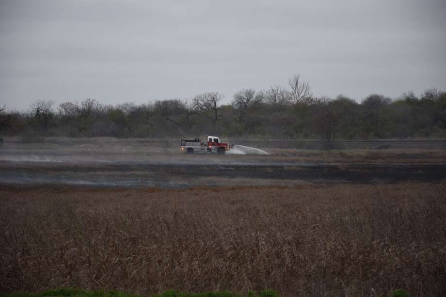 At least 13 San Antonio Fire Department units responded to a large brush fire in the 9400 block of New Laredo Hwy on February 23, 2015. Photo: By Mark D. Wilson/San Antonio Express-News