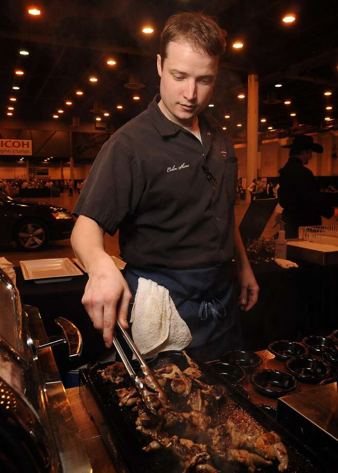 Colin Shine from Frank's American Revival cooks quail legs at the Rodeo Uncorked! Roundup and Best Bites Competition at NRG Center Sunday Feb. 22,2015.(Dave Rossman Photo) Photo: Dave Rossman, For The Chronicle