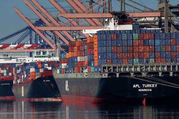 Container ships wait to be unloaded at the Port of Los Angeles on Monday. Nearly all West Coast seaports began the week with dockworkers hustling to load and unload cargo ships that were held up amid a months-long labor-management dispute.