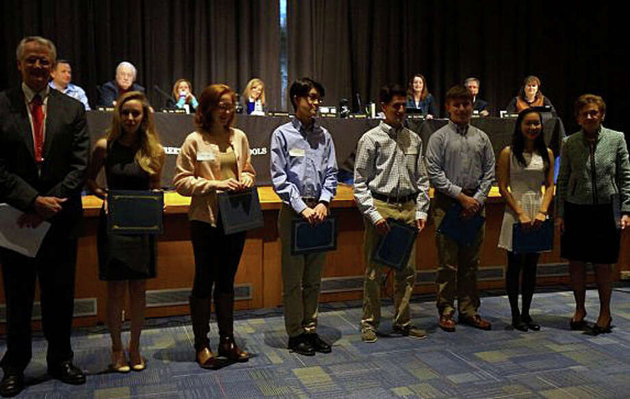 Greenwich High School has 15 finalists in the 2015 National Merit Scholarship Program. The students were honored at a Board of Education meeting on Oct. 23, 2014, at Central Middle School. From left, are: Superintendent of Schools William McKersie, Olivia Scharfman, Pascale Carrel, Andrew Ma, Charles Novek, Peter Russell, Julia Wang and Board of Education Chairman Barbara O'Neill. Photo: Paul Schott / Greenwich Time