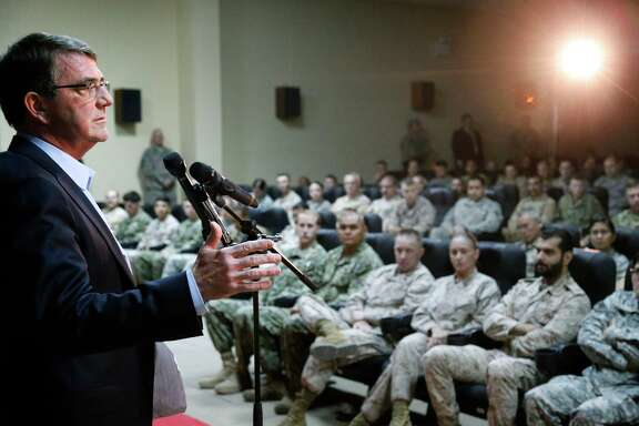 U.S. Defense Ash Carter addresses troops at Camp Arifjan, Kuwait, where top commanders and diplomats discussed the approach to the Islamic State group.