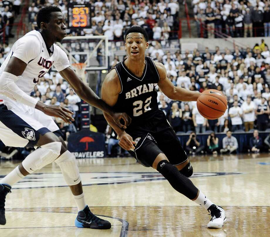 Former Bethel High standout Dan Garvin, now a sophomore on the Bryant University menâÄôs basketball team, in action on Nov. 14, 2014 against UConn. Photo: Jessica Hill, Contributed Photo / The News-Times Contributed