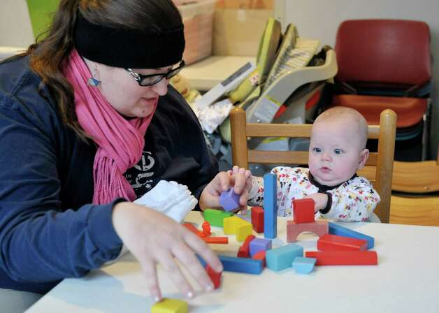 Mary Tubbs from Schenectady plays with her son, Garrus, four months old, at The Building Blocks of the City Room program at the Albany Heritage Area Visitors Center on Monday, Feb. 23, 2015, in Albany, N.Y.  (Paul Buckowski / Times Union) Photo: PAUL BUCKOWSKI / 00030095A