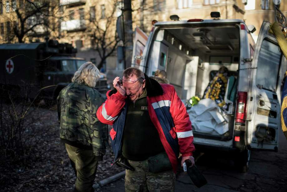 During a ceremony in Artemivsk, eastern Ukraine, a member of the Ukrainian military medical unit cries for his four comrades killed near Debaltseve. Photo: Evgeniy Maloletka / Associated Press / AP