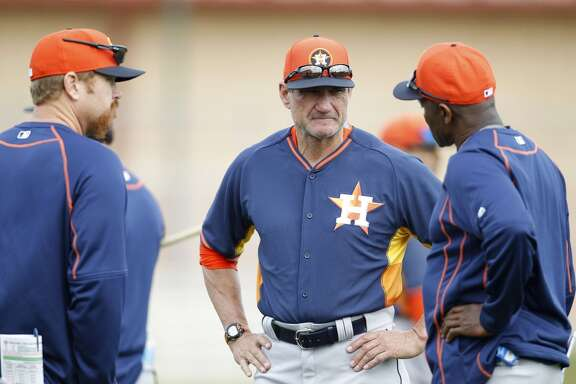 Houston Astros hitting coach Dave Hudgens, center, chats with other coaches during spring training workouts for pitchers and catchers at their Osceola County training facility, Monday, Feb. 23, 2015, in Kissimmee. ( Karen Warren / Houston Chronicle  )