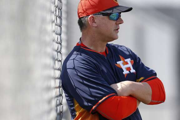 Houston Astros manager A.J. Hinch (14) watches pitchers during spring training workouts for pitchers and catchers at their Osceola County training facility, Monday, Feb. 23, 2015, in Kissimmee. ( Karen Warren / Houston Chronicle  )
